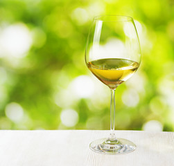 Glass of wine on nature background