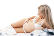 The pregnant woman lays isolated