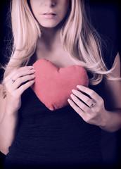 Holding plush heart