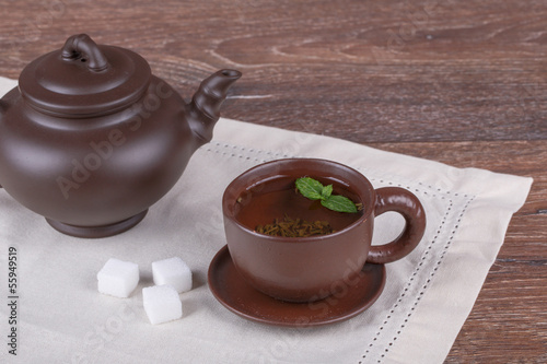 Green tea in clay cup