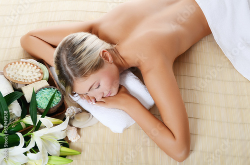 Spa beautiful Woman on bamboo rug