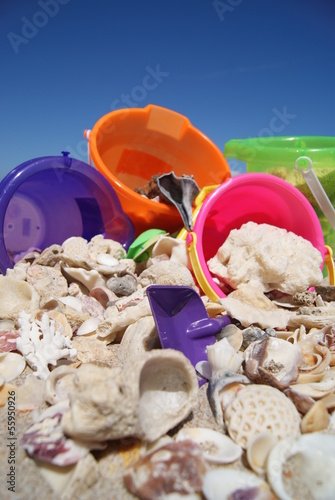 Sand Buckets and Shells on Beach in Florida