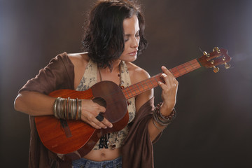 Cute four string guitar performer