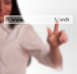 Business woman pushing touch screen search web