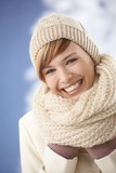 Happy young woman in winter clothes