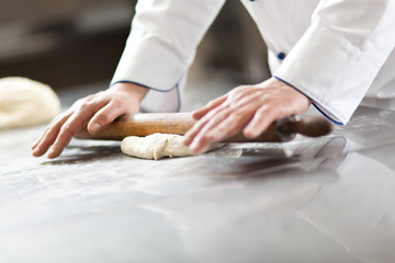Chef prepairing dough in the kitchen