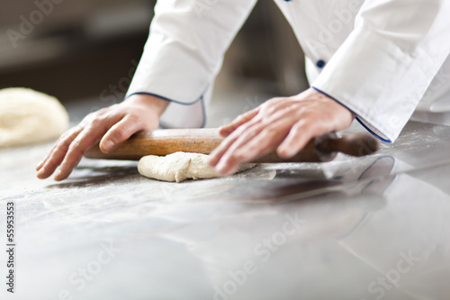 Chef prepairing dough in the kitchen