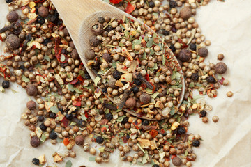Garam masala ingredients on a spoon