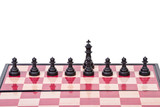 Chessboard with black pawns and king