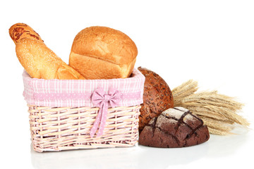 Baked bread in wicker basket isolated on white