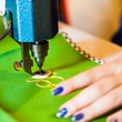 Lady hand at sewing
