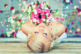 Fototapety Beautiful blonde bride with a bouquet of flowers
