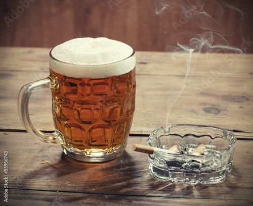Pint of Beer and a lit cigarette.