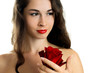 Young beautiful woman holding red rose