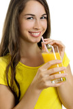 Beautiful woman drinking orange juice