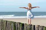 Fototapety Mädchen am Strand