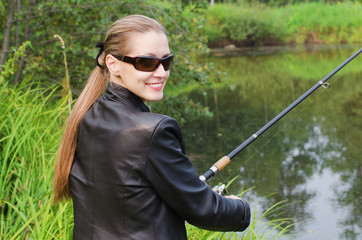 The beautiful young woman on fishing
