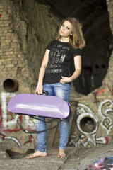 beautiful girl with purple briefcase in hand