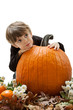 Child Hugging Pumpkin