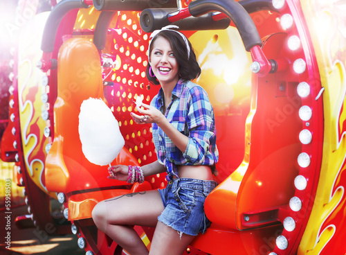 Lifestyle. Happy Woman Eating Sweetened Cotton Candy in Funfair