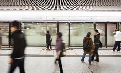 blur people walk at subway station