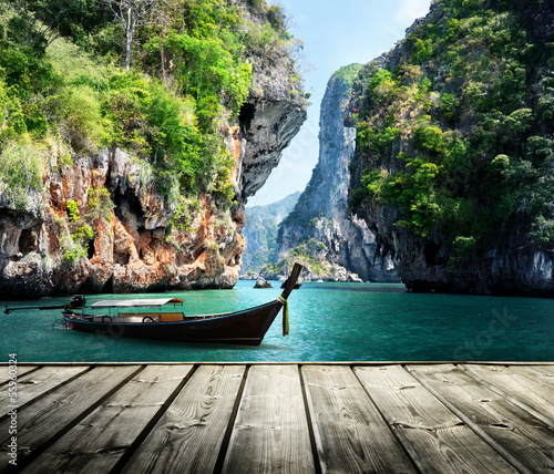 long boat and rocks on railay beach in Krabi, Thailand - 55960324