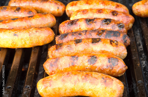 Italian sausages on grill