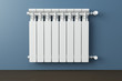 canvas print picture - Heating radiator in a room with laminated wooden floor