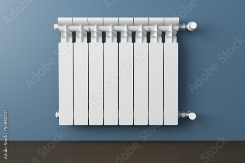 canvas print picture Heating radiator in a room with laminated wooden floor
