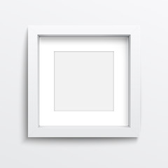 White square frame on gray wall.