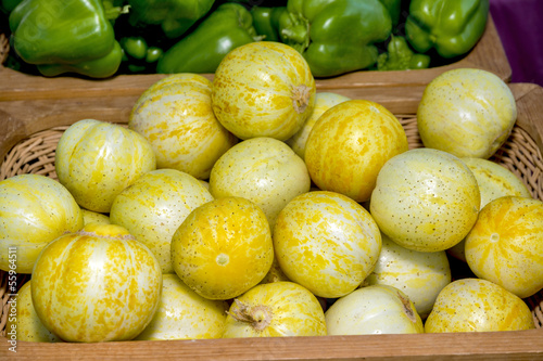 Round yellow vegetables in a basket at a market