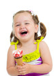 smiling kid girl eating ice cream isolated
