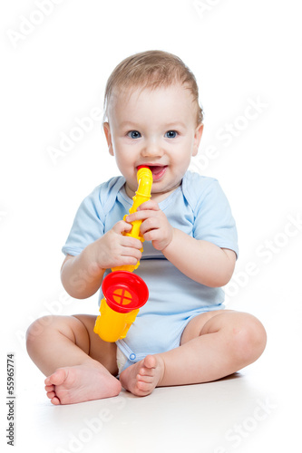 child boy playing musical toy isolated on white