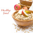 healthy breakfast - oat flakes with apples in a bowl