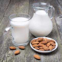 Jug and glass cup with almond milk