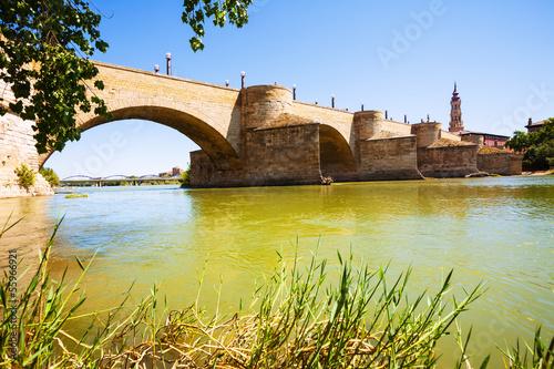 Puente de Piedra at Zaragoza in sunny day