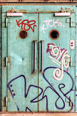 Vandalized lift door in an abandoned factory