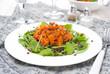 salad with arugula, black lentils and vegetable stew