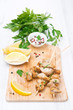 skewers of chicken with lemon and parsley on a wooden board