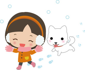 雪にはしゃぐ女の子と犬