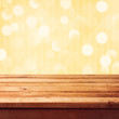 Golden bokeh background with empty wooden deck table