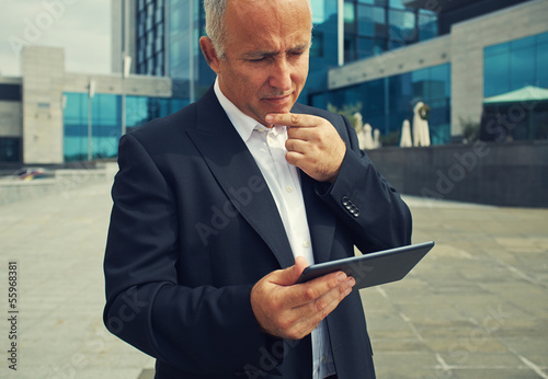 man looking at tablet pc