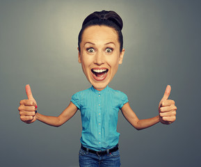 woman with big head showing two thumbs up