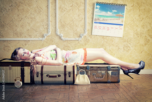 woman, sleeping on the luggage