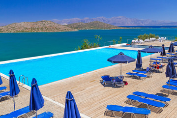 Swimming pool with sunbeds at Mirabello Bay in Greece