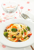 Spaghetti with broccoli and tomatoes