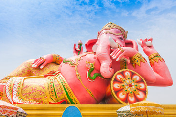 Pink ganesha in relaxing protrait on blue sky