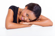 young african woman lying on a desk