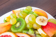 Assortment of sliced fruits on plate