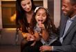 Interracial family having fun at home smiling